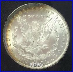 1882 CC Morgan Silver Dollar NGC GSA MS66 With Rainbow Toning No Box Or COA